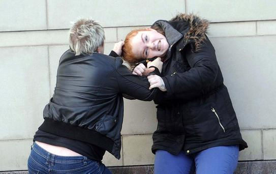Two women exchange blows at Laganside court in Belfast following a disagreement. Court staff split the pair apart before police and an ambulance were called to the scene. Photo by Pacemaker