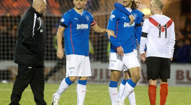 Rangers' Bilel Mohsni argues with Airdrieonians' manager Gary Bollan at the end of the match during the Scottish League One match at the Excelsior Stadium, Airdrie.