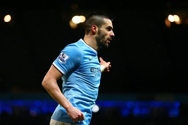 MANCHESTER, ENGLAND - JANUARY 08: Alvaro Negredo of Manchester City celebrates scoring his second goal during the Capital One Cup Semi-Final first leg match between Manchester City and West Ham United at Etihad Stadium on January 8, 2014 in Manchester, England. (Photo by Clive Mason/Getty Images)