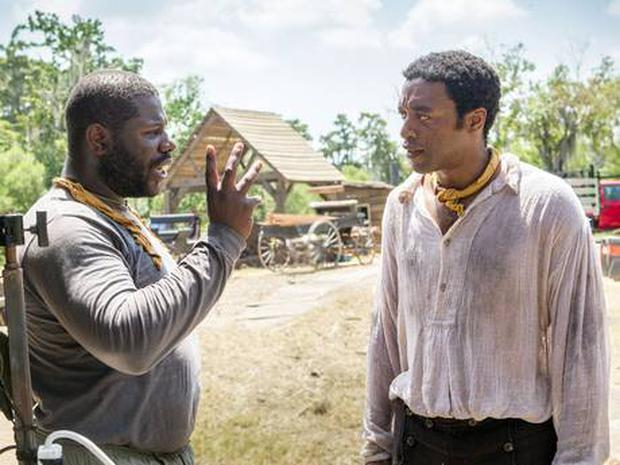 '12 Years a Slave'; director Steve McQueen and Chiwetel Ejiofor talk on set (Rex)