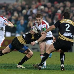 10/1/2014. PACEMAKER PRESS INTL. Paddy Jackson is tackled by Enzo Selponi during this evenings Heineken Cup Pool 5 game between Ulster and Montpellier at Ravenhill, Belfast. PICTURE CHARLES MCQUILLAN/PACEMAKER.
