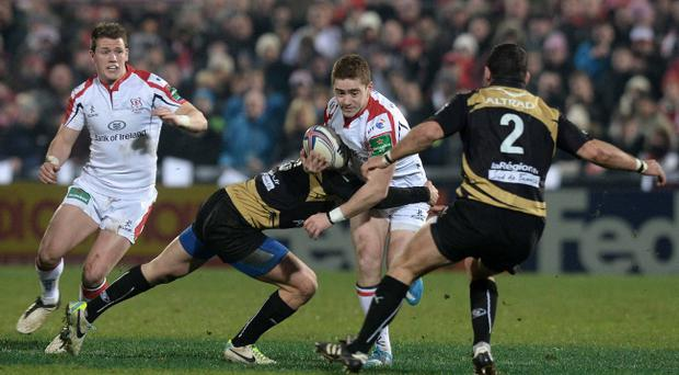 Paddy Jackson is tackled by Enzo Selponi during Friday's Heineken Cup Pool 5 game between Ulster and Montpellier at Ravenhill, Belfast Pic Charles McQuillan