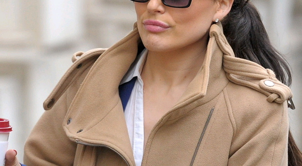 Chalottte Devaney, 34, leaves Bristol Crown Court where she is accused, with three lapdancers who she managed, of kidnapping a club boss after he failed to pay them more than £42,000