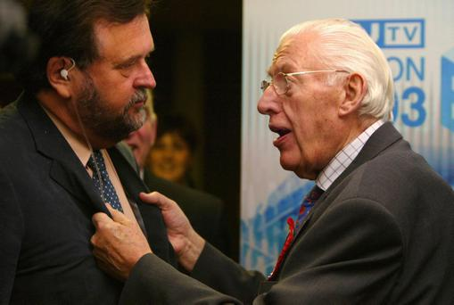 Rev Ian Paisley grabs journalist Ivan Little during a TV interview at the North Antrim count at Ballymoney in the Northern Ireland election, November 27 2003