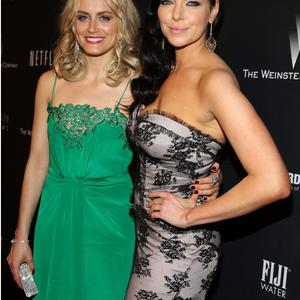 BEVERLY HILLS, CA - JANUARY 12: Actresses Taylor Schilling and Laura Prepon attend The Weinstein Company & Netflix's 2014 Golden Globes After Party presented by Bombardier, FIJI Water, Lexus, Laura Mercier, Marie Claire and Yucaipa Films at The Beverly Hilton Hotel on January 12, 2014 in Beverly Hills, California. (Photo by Imeh Akpanudosen/Getty Images for The Weinstein Company)