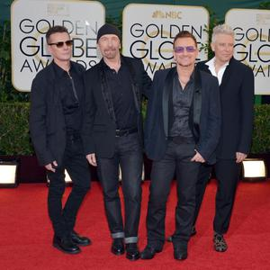 From left, Larry Mullen, Jr., The Edge, Bono and Adam Clayton, of the musical group U2, arrive at the 71st annual Golden Globe Awards at the Beverly Hilton Hotel on Sunday, Jan. 12, 2014, in Beverly Hills, Calif. (Photo by John Shearer/Invision/AP)