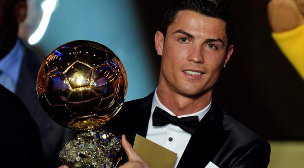 0338668c1c5 ... wins Fifa Ballon d Or 2013. Cristiano Ronaldo of Portugal is awarded  the prize for the FIFA Men s soccer player of the