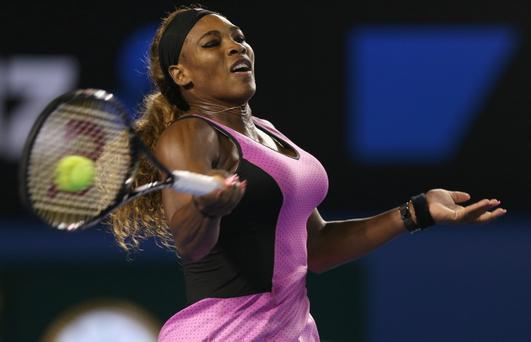 MELBOURNE, AUSTRALIA - JANUARY 13: Serena Williams of USA plays a forehand in her first round match against Ashleigh Barty of Australia during day one of the 2014 Australian Open at Melbourne Park on January 13, 2014 in Melbourne, Australia. (Photo by Clive Brunskill/Getty Images)