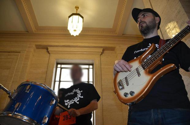 Saverio Bellante (34) is pictured playing a bass guitar at Stormont in 2012