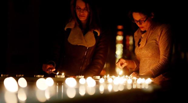 People at a prayer vigil held for Tom O'Gorman, who was found dead at his home in Castleknock, is held at St Teresa's, Clarendon St, Dublin.
