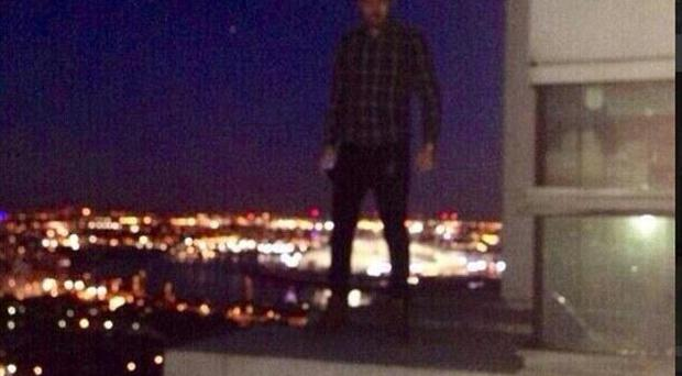 The image Liam Payne posted on Twitter showing him teetering on the edge of a balcony