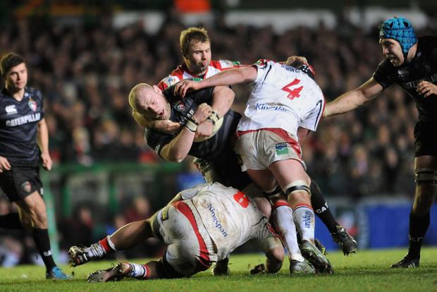 Leicester Tigers' Dan Cole is tackled by Ulster Rugby's Roger Wilson, Nick Williams and Johann Muller during the Heineken Cup, Pool Five at Welford Road, Leicester