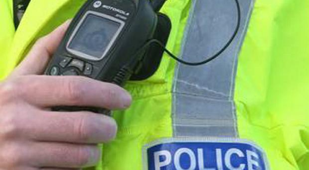 Police are probing a link between two filling station armed robberies in Belfast