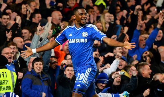 Samuel Eto'o of Chelsea celebrates after scoring his team's third goal and completing his hat trick