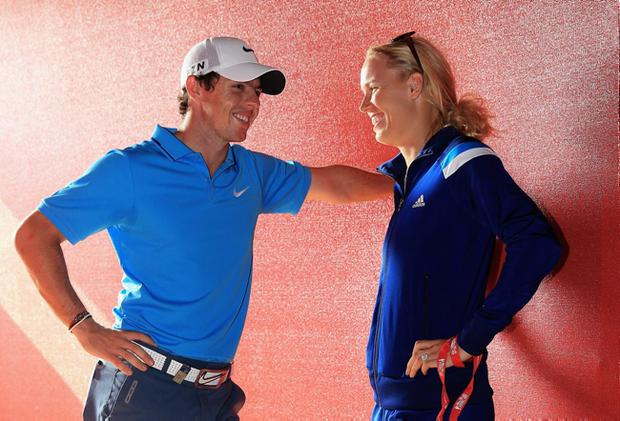 Rory McIlroy talks to his fiance Caroline Wozniacki of Denmark, after coming joint second after the final round of the Abu Dhabi HSBC