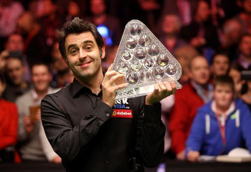 Ronnie O'Sullivan celebrates after winning the Masters