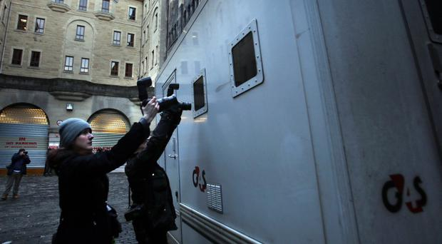 Members of the media photograph a prison van arriving at Edinburgh Sheriff court as Rosdeep Kular, mother of three-year-old Mikaeel Kular, appeared at court