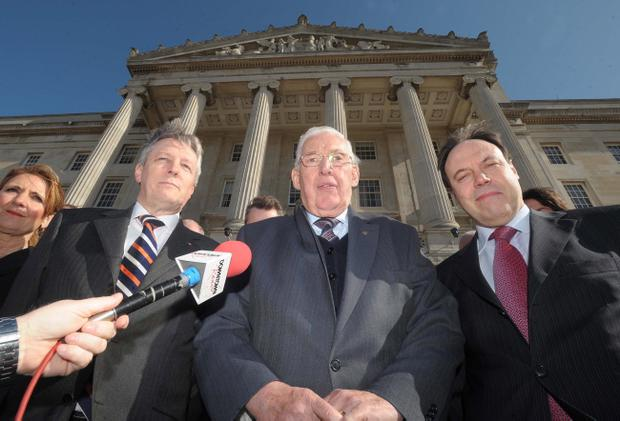Pictured in 2008, DUP leader elect Peter Robinson on the steps of Stormont with Ian Paisley and Nigel Dodds
