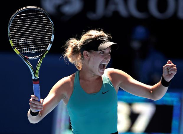 Eugenie Bouchard of Canada celebrates after defeating Ana Ivanovic of Serbia during their quarter-final in Melbourne