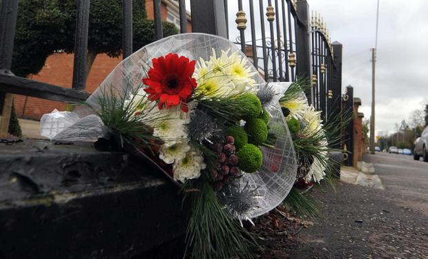 Flowers left at the scene on the Comber Road after two-year-old Rham Gavriel Alvarez was killed by a runaway car in Dundonald in 2012. Pic Colm Lenaghan/Pacemaker