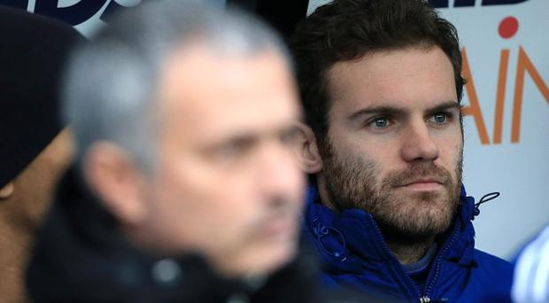 Chelsea's Juan Mata (right) and manager Jose Mourinho. Midfielder Mata looks set for a move to Manchester United