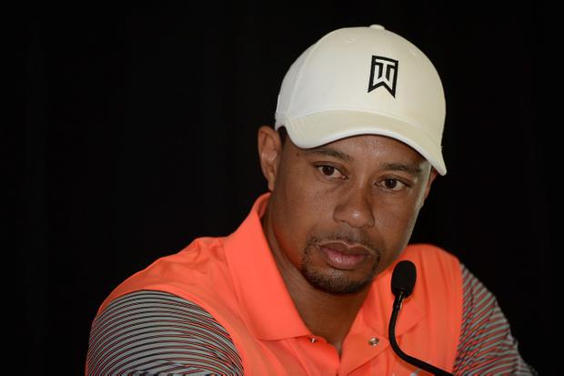 LA JOLLA, CA - JANUARY 22: Tiger Woods is interviewed in the media center after his the Pro-Am round for the Farmers Insurance Open at Torrey Pines Golf Course on January 22, 2014 in La Jolla, California. (Photo by Donald Miralle/Getty Images)