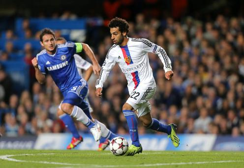 File photo dated 18/09/2013 of FC Basel's Mohamed Salah (right) takes on Chelsea's Frank Lampard. Salah has been linked with a move to Stamford Bridge