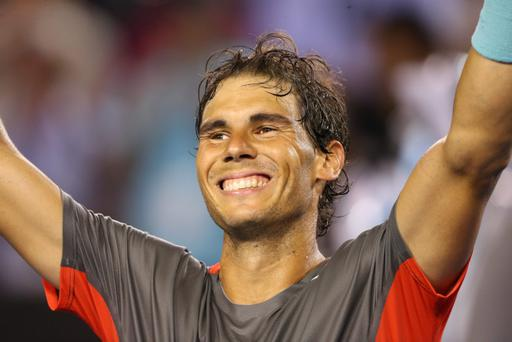 MELBOURNE, AUSTRALIA - JANUARY 24: Rafael Nadal of Spain celebrates winning his semifinal match against Roger Federer of Switzerland during day 12 of the 2014 Australian Open at Melbourne Park on January 24, 2014 in Melbourne, Australia. (Photo by Quinn Rooney/Getty Images)