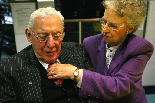 Eileen Paisley fixes her husband Ian Paisley's tie at the Seven Towers Leisure Centre in Ballymena, Co Antrim, Thursday March 8, 2007