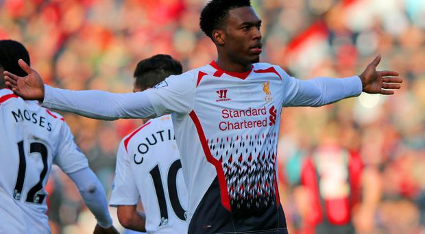 BOURNEMOUTH, ENGLAND - JANUARY 25: Daniel Sturridge of Liverpool celebrates scoring their second goal during the FA Cup Fourth Round match between Bournemouth and Liverpool at Goldsands Stadium on January 25, 2014 in Bournemouth, England. (Photo by Ian Walton/Getty Images)