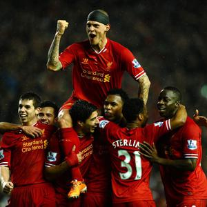 Daniel Sturridge of Liverpool is congratulated by teammates after scoring