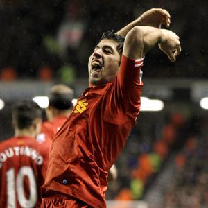 Luis Suarez celebrates scoring the fourth