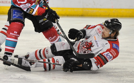 28/1/14: Chris Higgins of the Belfast Giants in action against Matthew Myers of the Cardiff Devils during the Challenge Cup Semi-Final first leg game at the Odyssey Arena, Belfast.