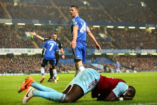 LONDON, ENGLAND - JANUARY 29: Gary Cahill of Chelsea looks to the linesman as Mohamed Diame of West Ham lies on the pitch during the Barclays Premier League match between Chelsea and West Ham United at Stamford Bridge on January 29, 2014 in London, England. (Photo by Ian Walton/Getty Images)