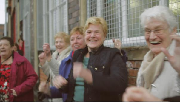 Locals dance for the camera in the Belfast Is Happy video