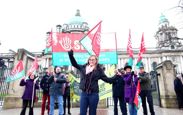 Aimee Conlon takes the lead in the trade union protest outside Belfast City Hall yesterday afternoon