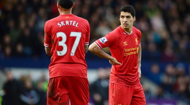 WEST BROMWICH, ENGLAND - FEBRUARY 02: Luis Suarez (L) speaks with teammate Martin Skrtel of Liverpool during the Barclays Premier League match between West Bromwich Albion and Liverpool at The Hawthorns on February 2, 2014 in West Bromwich, England. (Photo by Jamie McDonald/Getty Images)
