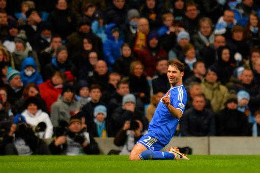 Branislav Ivanovic of Chelsea celebrates scoring their first goal during the Barclays Premier League match between Manchester City and Chelsea at Etihad Stadium