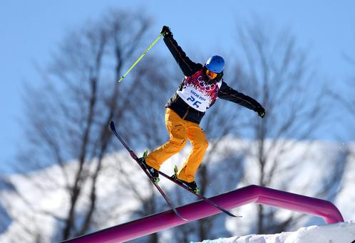 An unknown athlete makes a jump during the ski slopestyle training at the Rosa Khutor Park