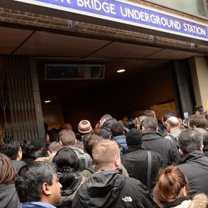 Commuters at London Bridge Underground Station as a strike on London Underground caused gridlock on roads and massive disruption on Tubes and buses.