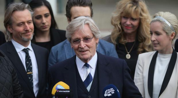 PRESTON, LANCASHIRE - FEBRUARY 06: Actor William Roache (C) with his daughter Verity Roache (R) and Linus Roache (L) speaks to the media after leaving Preston Crown Court after being found not guilty over historical sexual offence allegations on February 6, 2014 in Preston, Lancashire. On the 17th day of the trial the jury reached a verdict for the Coronation Street star, who plays the character Ken Barlow on the ITV soap. Roache was found innocent of two rape and four indecent assault allegations which relate to incidents between 1965 and 1971. (Photo by Christopher Furlong/Getty Images)