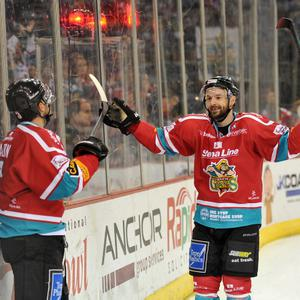 Jeff Mason (left) of the Belfast Giants celebrates scoring the goal against with Colin Shields of the Hull Stingrays during the Elite League game at the Odyssey Arena, Belfast. Picture: Michael Cooper