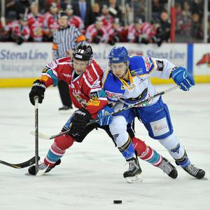 Dustin Whitecotton of the Belfast Giants in action against Jamie Chilcot of the Hull Stingrays during the Elite League game at the Odyssey Arena, Belfast. Picture: Michael Cooper