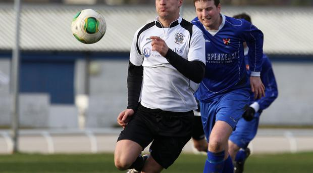Action from the Irish Cup sixth round where Lisburn Distillery took on Queen's University