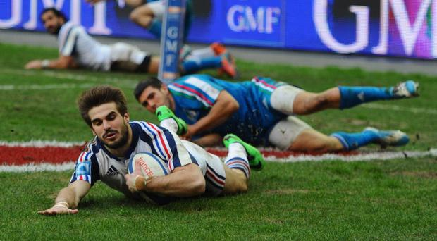 PARIS, FRANCE - FEBRUARY 09: Hugo Bonneval of France scores a try during the RBS Six Nations match between France and Italy at Stade de France on February 9, 2014 in Paris, France. (Photo by Mike Hewitt/Getty Images)