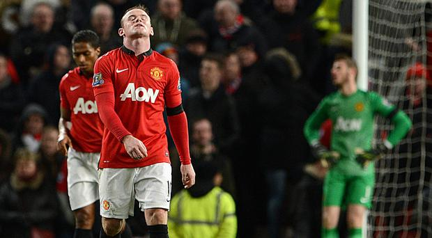 MANCHESTER, ENGLAND - FEBRUARY 09: Wayne Rooney of Manchester United reacts after Fulham's second goal during the Barclays Premier League match between Manchester United and Fulham at Old Trafford on February 9, 2014 in Manchester, England. (Photo by Michael Regan/Getty Images)