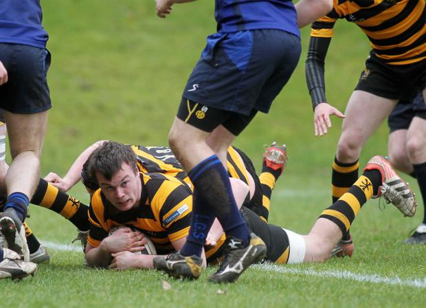 Starring role: RBAI's Andrew McGrath scores a try in the victory over Dalriada, a score that proved crucial to the outcome of the match presseye