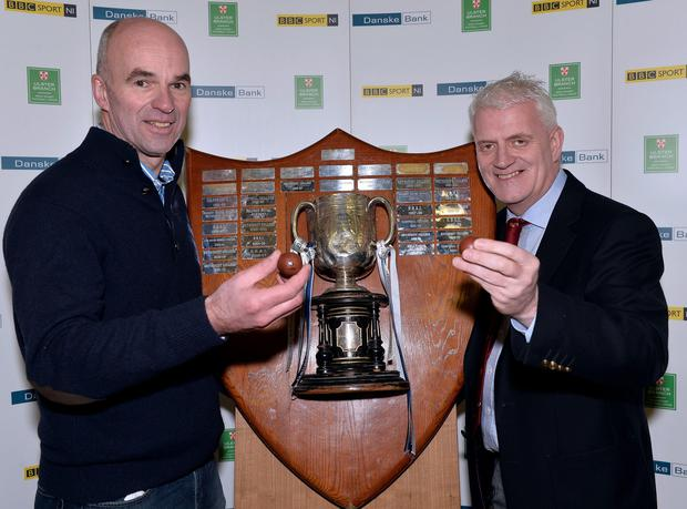Top billing: Peter Beattie from Danske Bank and Stephen Black, Ulster Schools' Committee, make the draw for the quarter-finals of the Schools' Cup at Ballyclare High School PressEye