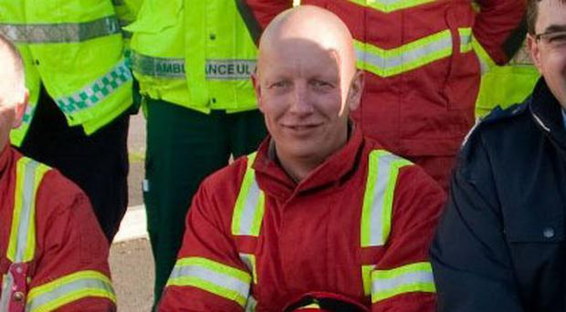 Nial Hamilton died after dealing with a car fire in Lurgan on Monday night
