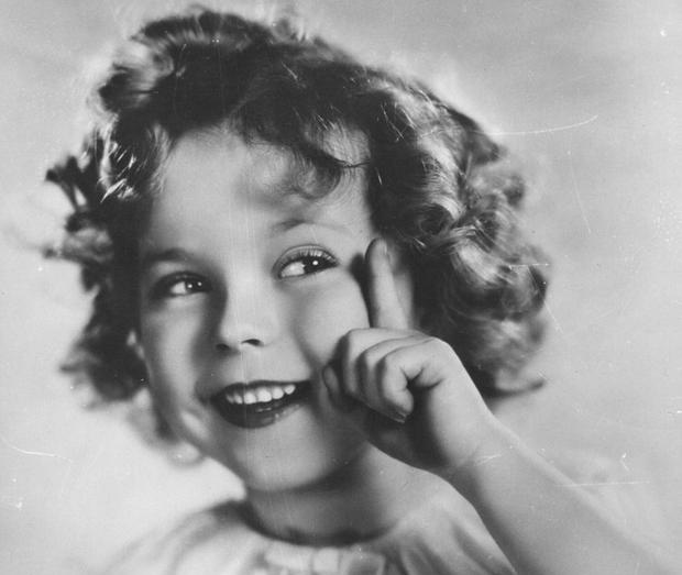 Circa 1934: Shirley Temple (1928 - ) the American child star who started performing in films at three years of age. She entered politics in the 1960's and took on several ambassador positions representing her country. (Photo by Hulton Archive/Getty Images)